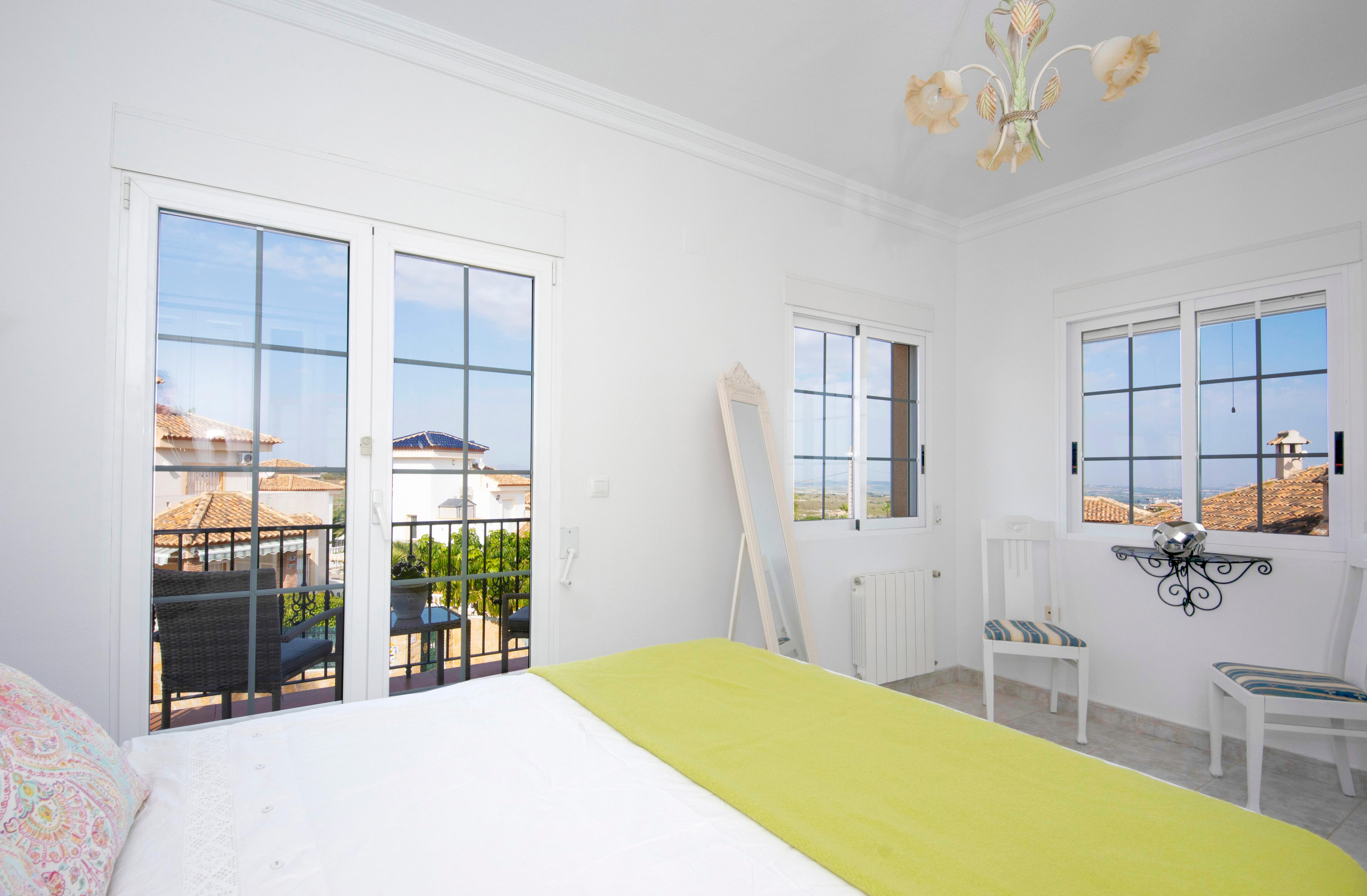 Real estate photography bedroom with window pulls