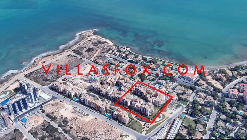 Luxury Punta Prima south-facing apartment with great sea views